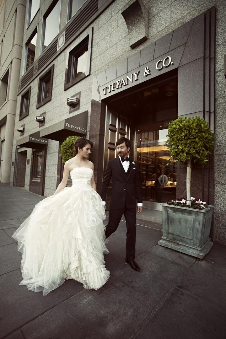 Bride and groom outside Tiffany & Co. in San Francisco