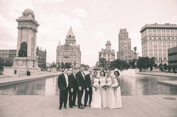 Black and white photo of bridesmaids and groomsmen with couple