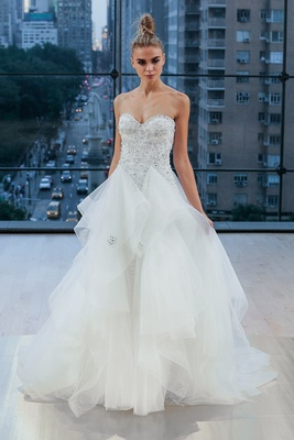 Embellished strapless sweetheart natural waist ball gown with playful handkerchief skirt.