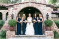 Bride in a strapless Hayley Paige dress and bridesmaids in one-shoulder Monique Lhuillier dresses