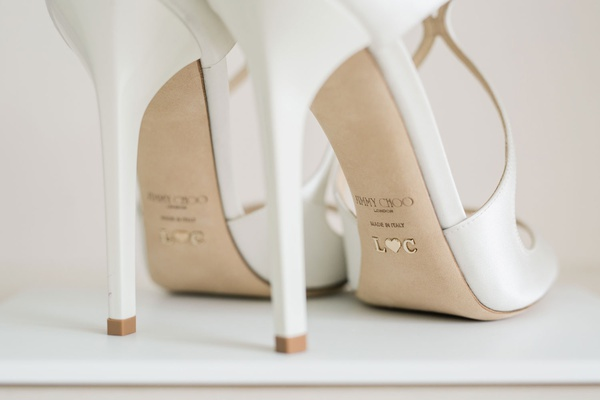 custom jimmy choo bridal shoes in white with initials in gold on the back