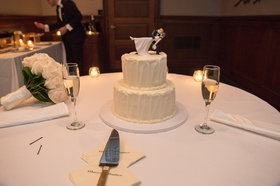 small two-tier wedding cake, cake topper with groom dipping bride