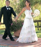 Tulle wedding dress with straps and embroidery