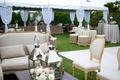 coastal reception lounge setting sofas chairs coffee table low centerpiece lanterns