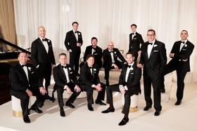 Wedding ceremony chicago groom and groomsmen tuxedo attire black tie white gold lounge furniture