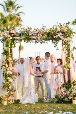 interfaith secular wedding, casual destination wedding, chuppah with florals