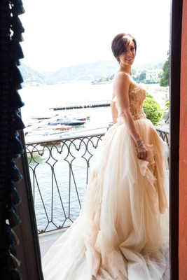Bride in wedding dress on Italian balcony