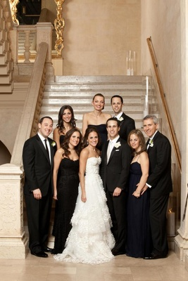 Bride and groom with guests in black tie clothing