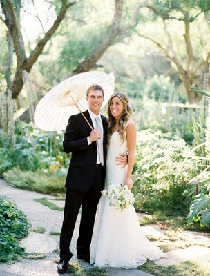 Bride in a Monique Lhuillier gown and groom