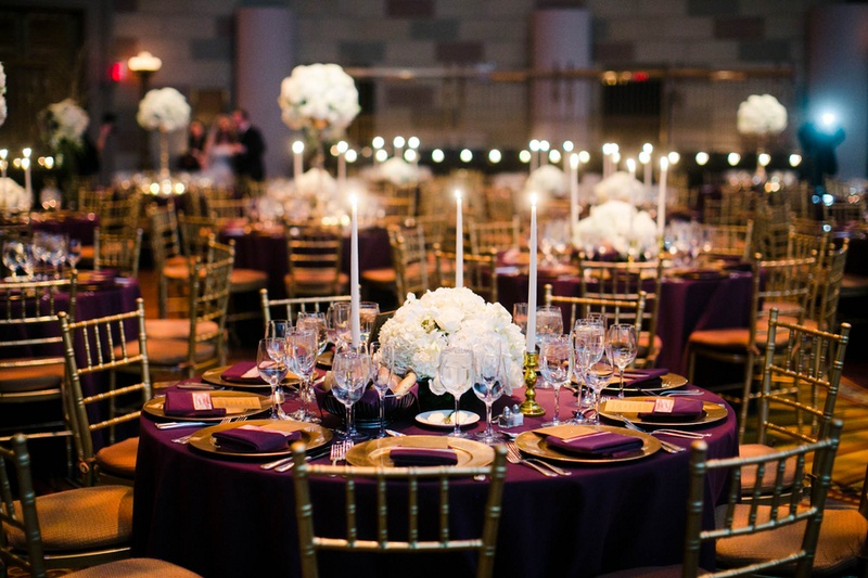 Round Wedding Reception Table With Purple Linen, Gold Plates, Tall Candles,  And White Part 25