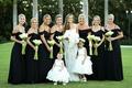 bride in monique lhuillier white lace wedding dress flower girls bridesmaids black gown off shoulder