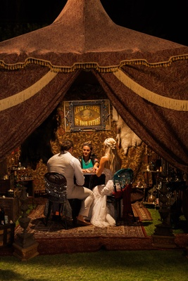 CJ Lana Perry and Miroslav Rusev Barnyashev at circus theme wedding fortune teller tent tarrot cards