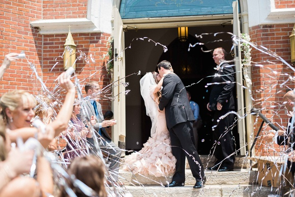 friends and family launch silver streamers as newlyweds in vera wang kiss