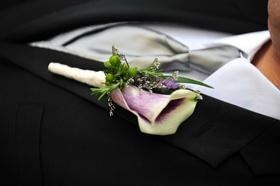 Picasso calla lily boutonniere with green berries