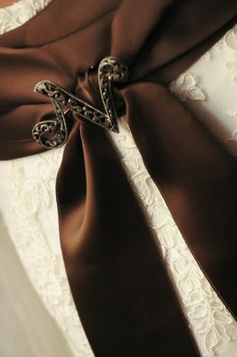 Brown wedding dress sash with N-shaped brooch