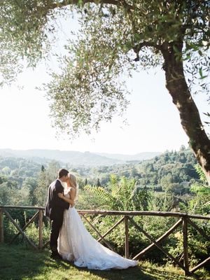bride and groom portrait sunlight italy countryside view of landscape olive trees strapless wedding