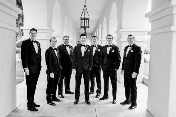 black and white photo of groom posing with groomsmen in arizona