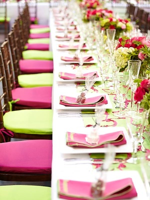 Long rectangular table lined with chairs