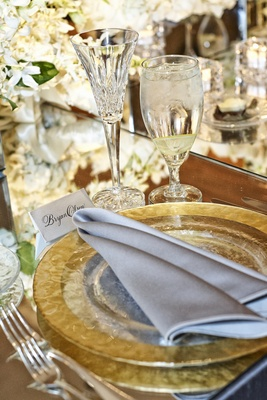 Crystal-cut Champagne flutes and charger plates