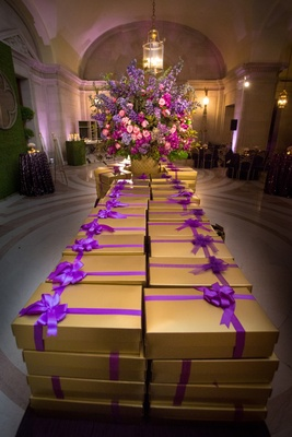 Boxed wedding favors on long banquet table