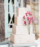 four-layer texture cake design with square tiers pink flowers and texture design