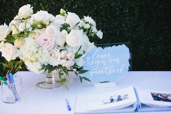 wedding guest book sign acrylic lucite with white calligraphy blue brushstroke design