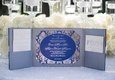 Silver invitation suite with pockets and royal blue invitation card with silver script