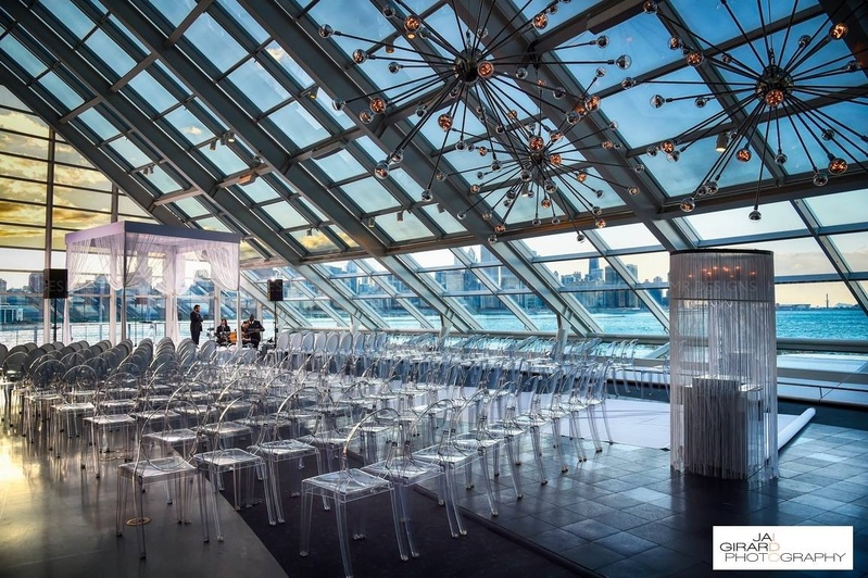 Lakefront view making beautiful the clear, glass ceremony decor.