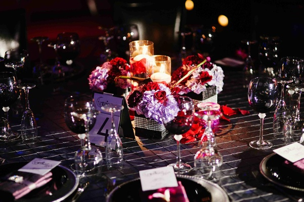 Gay wedding reception theater centerpiece with candles