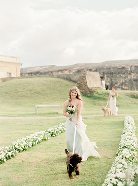 puerto rico wedding ceremony san cristobal fort white flowers bridesmaids pastel walking dogs