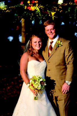 Bride in a lace Vera Wang gown and groom in a taupe suit