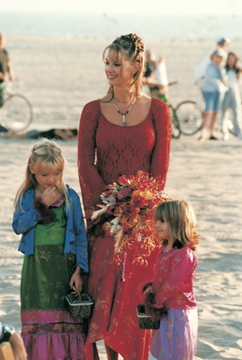 flower girls and bridesmaid at beach ceremony