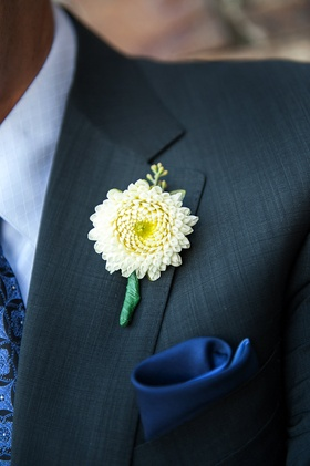 Chrysanthemum wedding boutonniere on groom's lapel