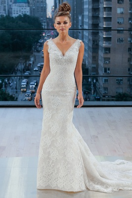 Tip the shoulder V-neck trumpet gown with V back accented with beaded appliqués at neckline and shou
