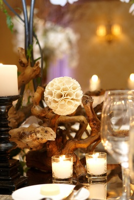 White rustic pod flower with woodsy centerpiece