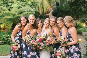 Bride with six bridesmaids in navy blue flower print dresses tropical wedding ideas