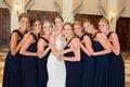bride in pronovias atelier wedding dress, bridesmaids in amsale navy bridesmaid dresses
