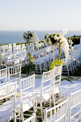 White chairs and aisle runner with ocean view