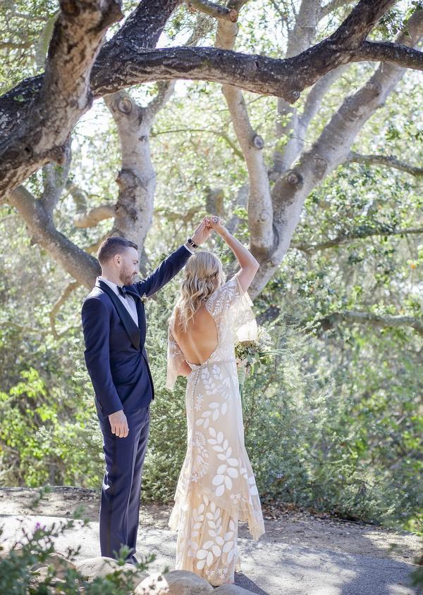 bohemian bride and groom couple dance in forest in santa barbara california