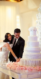 Mario Lopez and Courtney Mazza cutting cake
