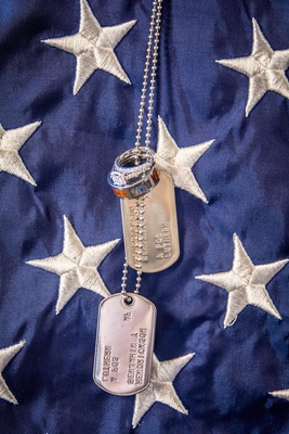 Rings on dogtag against American flag blue and white
