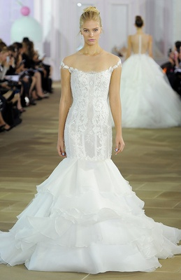 Off-the-shoulder tiered Silk Organza mermaid gown with drop waist corseted bodice and lace appliqué