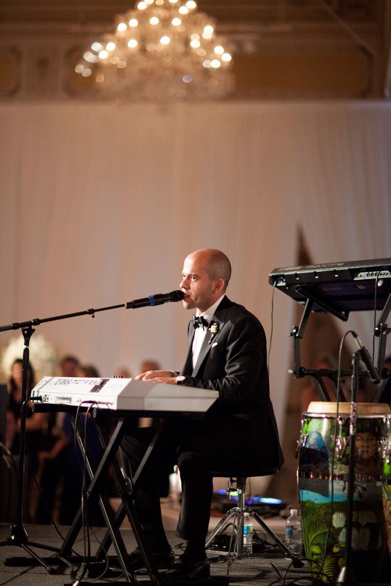 Wedding reception surprise performance by groom keyboard piano singing song written for bride