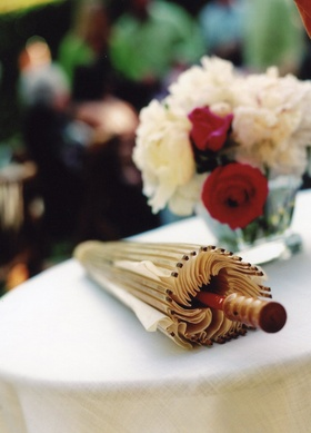 Parasol on cocktail hour table for guests to use