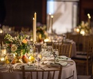 Wedding reception table art museum painting inspired centerpiece flowers fruit taper candles