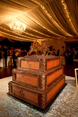 Wooden crate cake with leather binding and horse sculpture
