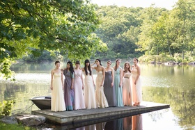 bride in custom mark ingraham atelier blush wedding gown, mismatched bridesmaids in soft colors