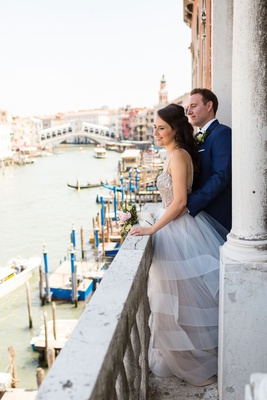 Bride in Hayley Paige wedding dress groom in navy blue tuxedo suit venice italy elopement views