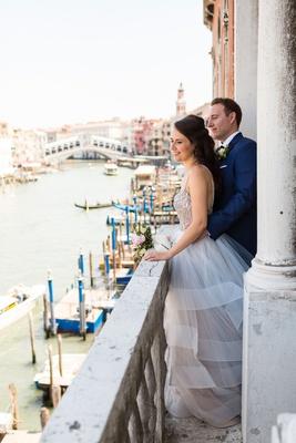 Bride in Hayley Paige wedding dress groom in navy blue tuxedo suit venice italy elopement views