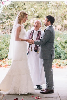 a bride and groom exchange vows in alfresco ceremony space